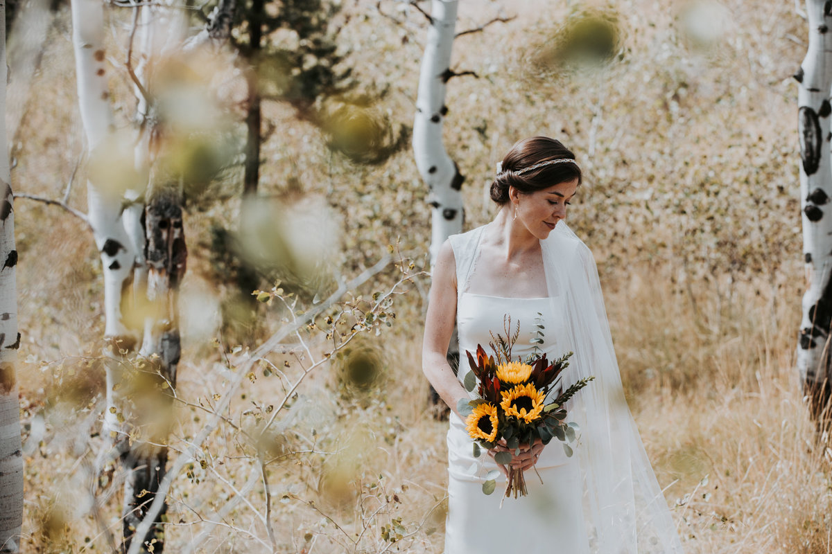 Bride holding sunflowers in Montana elopement