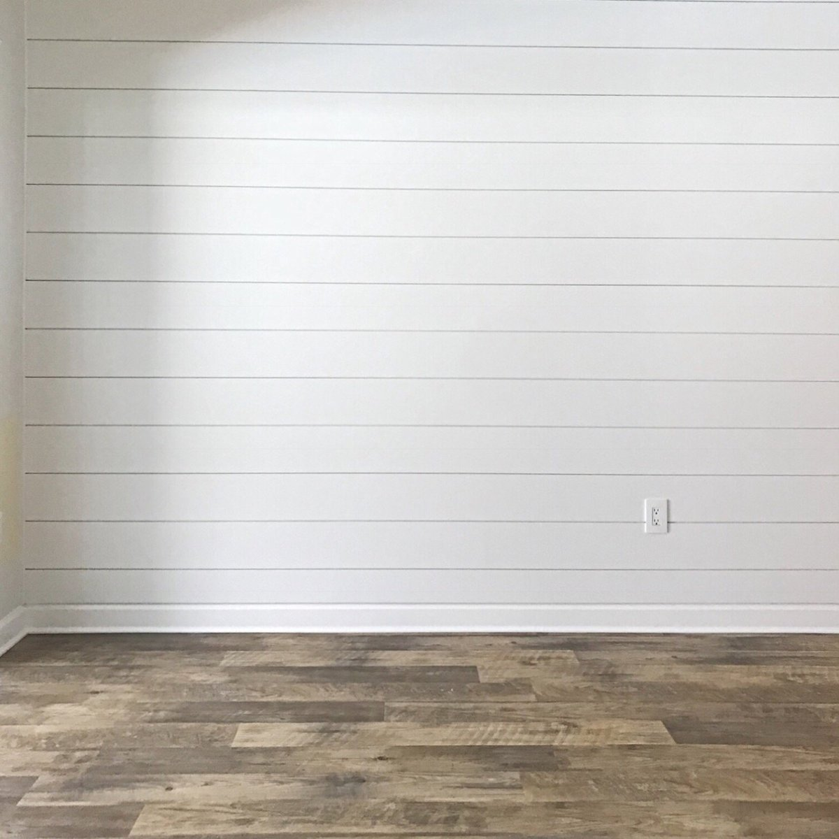 shiplap wall and vinyl flooring reno