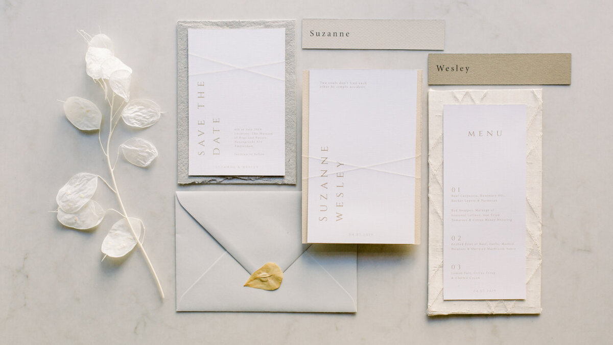 Elegant wedding stationery with golden touches for an intimate wedding photoshoot at the Tassenmuseum organized by Lovely & Planned