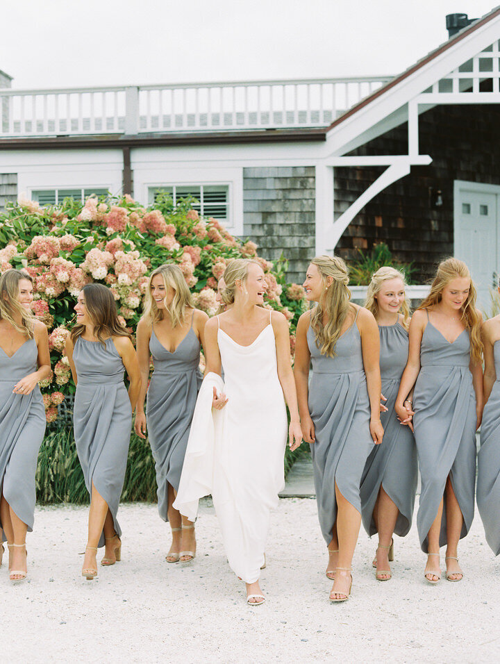 bridesmaids in grey dresses walking at newport castle hill inn