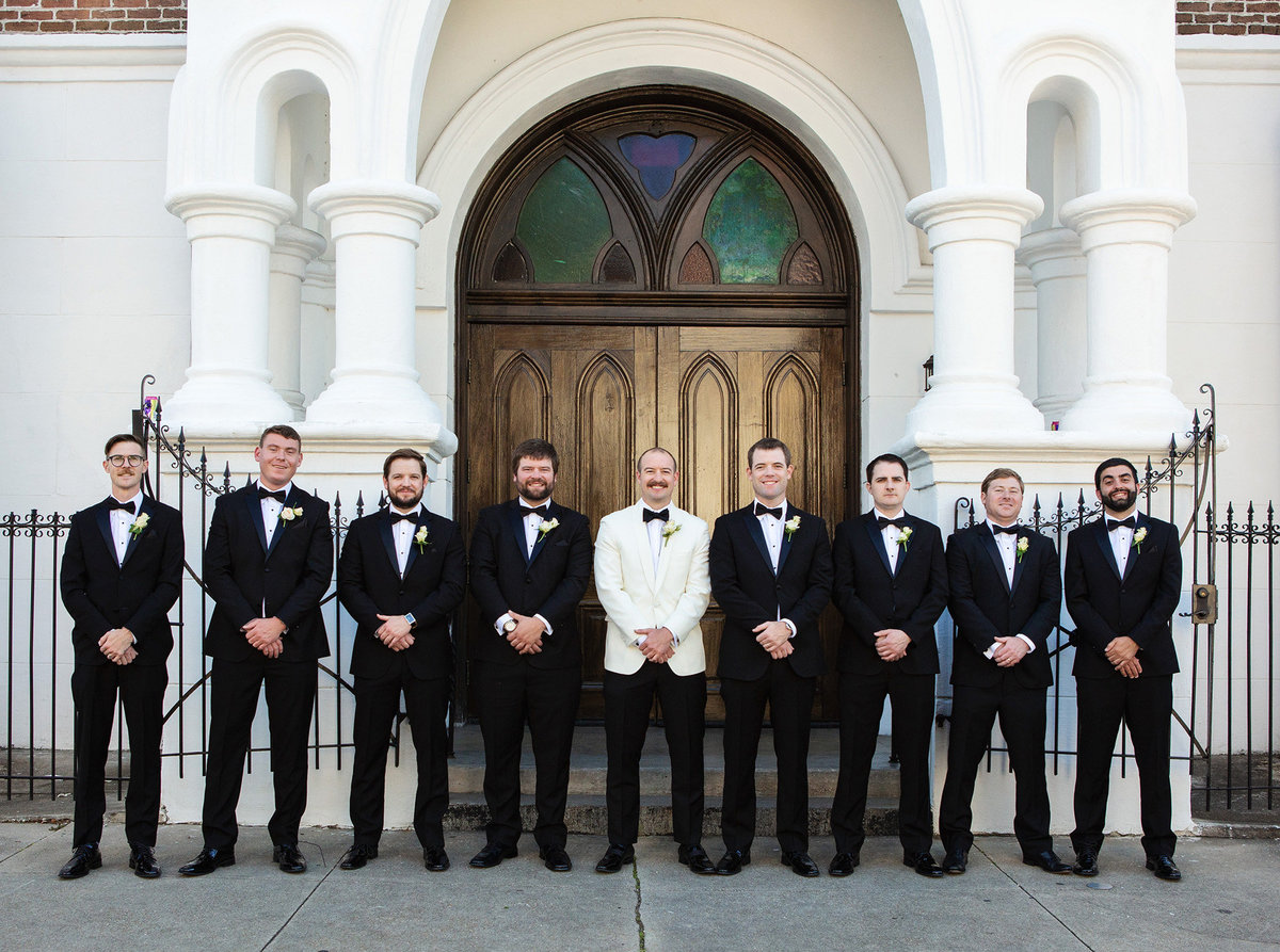 groom and his groomsmen in front of Felicity Church in New Orleans