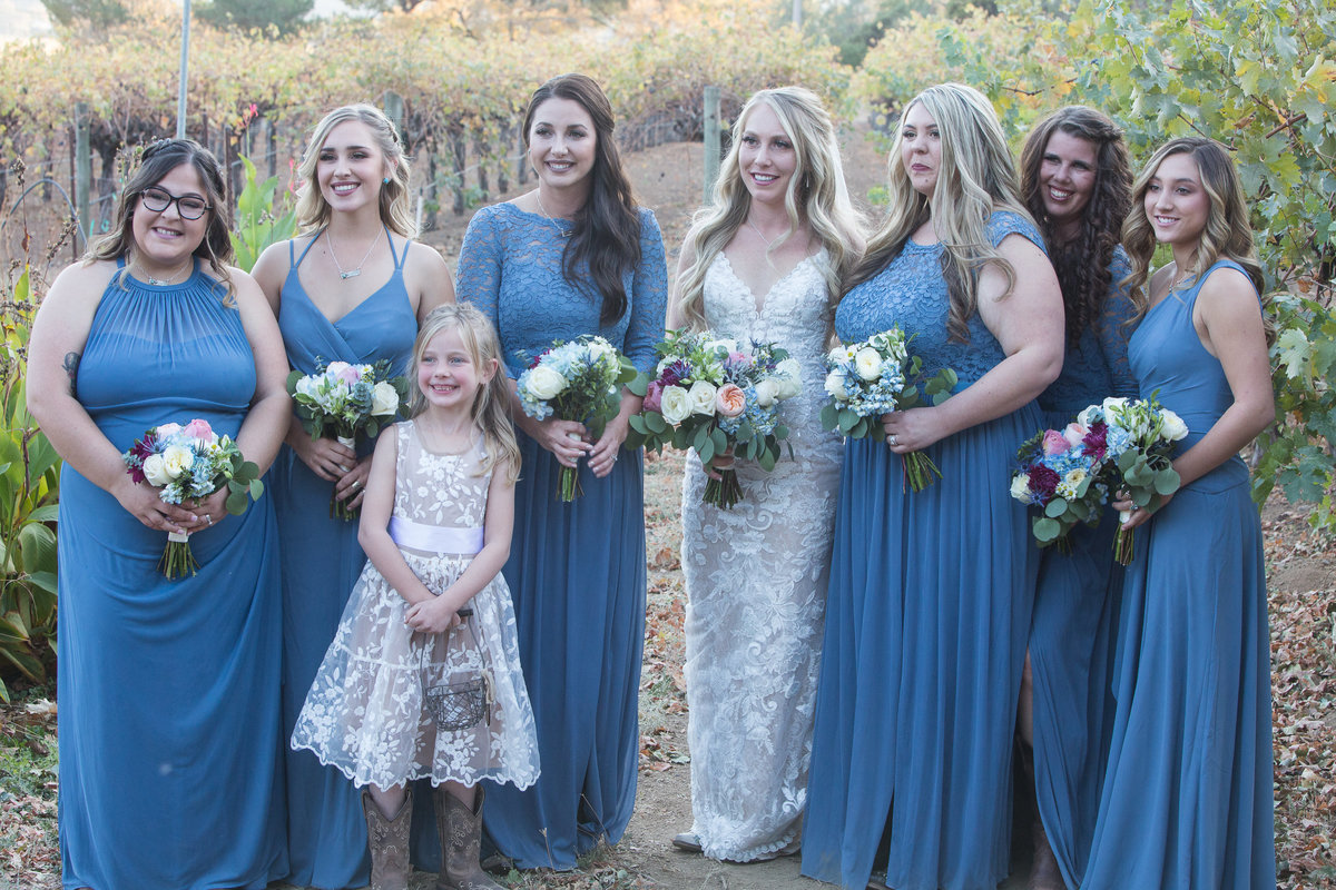 bridesmaids and bride  in vineyards