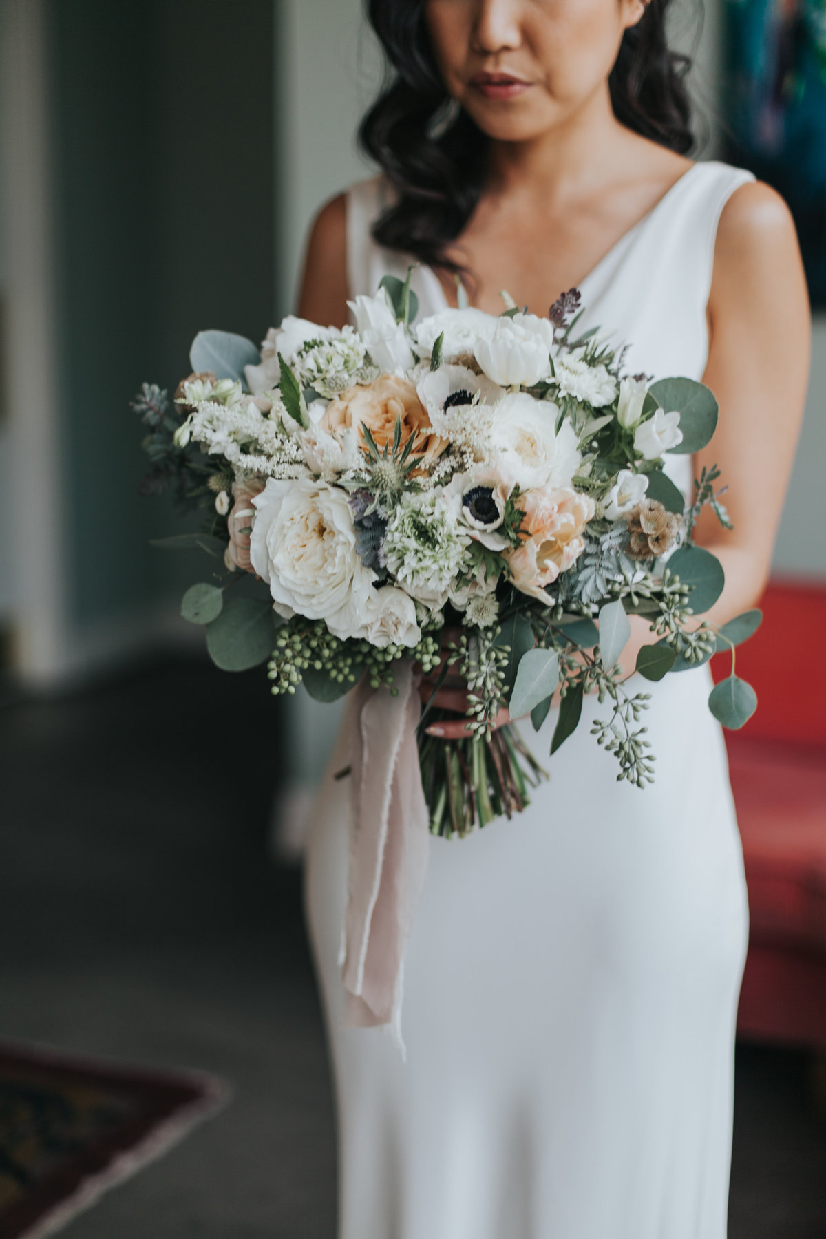 modern and classic bridal bouquet with eucalyptus and white flowers at The Fig House wedding