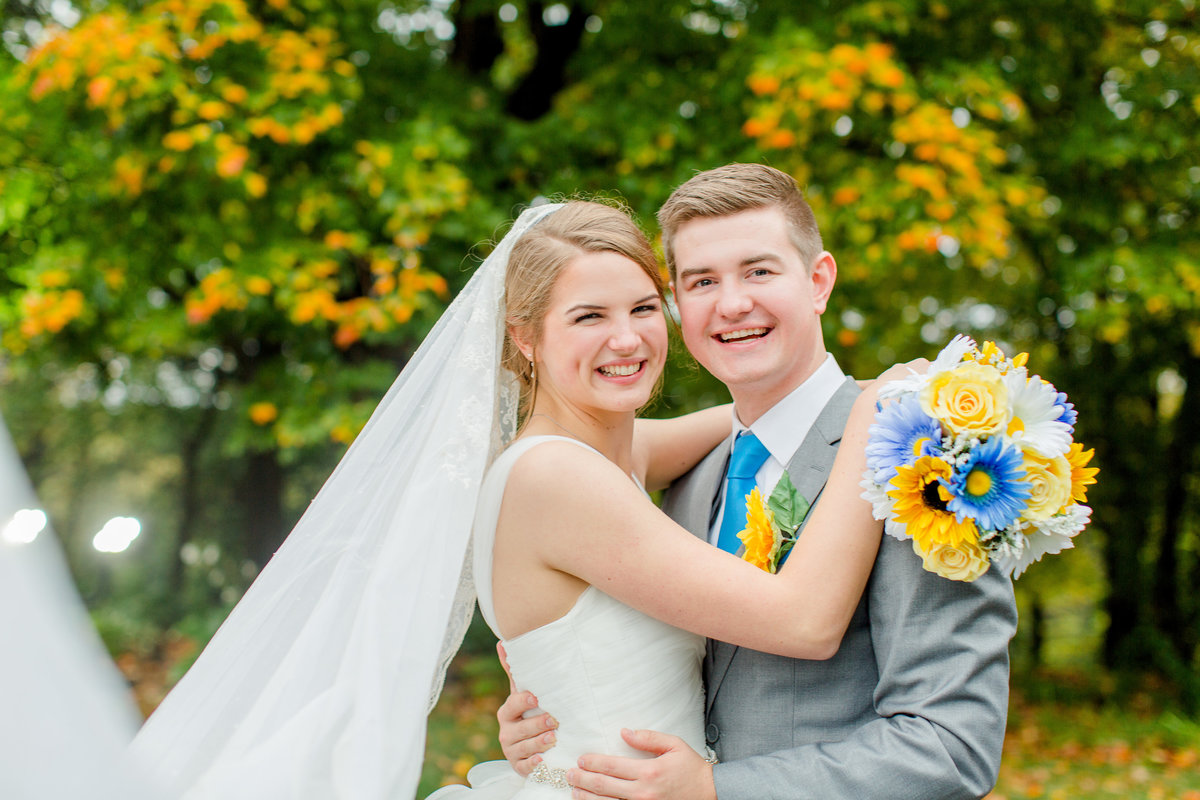 Fall wedding photos of the bride and groom at Saint Peter's Catholic Church in Mendota Heights, Minnesota