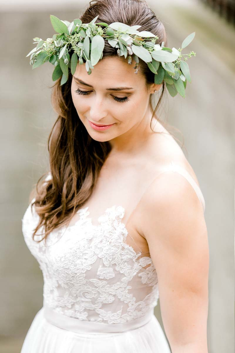 Portrait of a bride wearing a green flower crown on her wedding day.  Taken by K. Lenox Photography