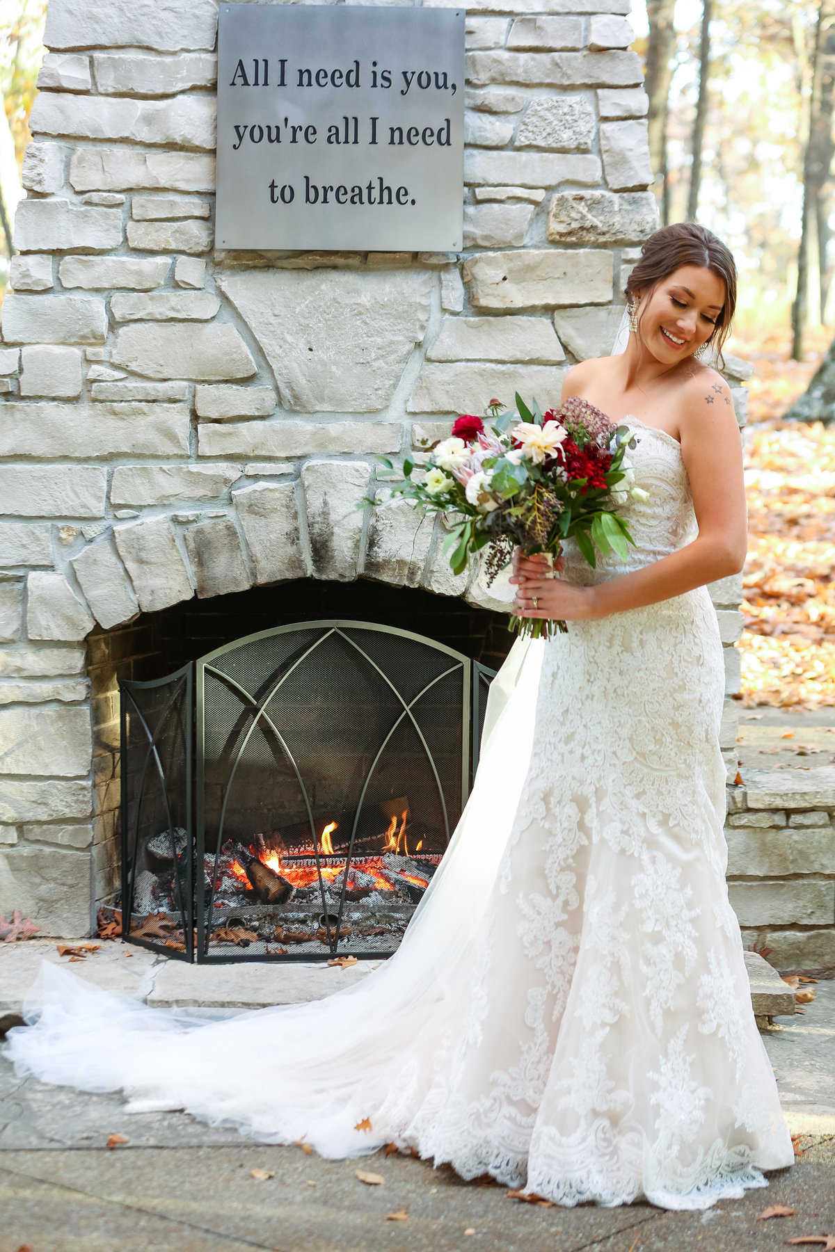 Romantic Fall Elopement  bride by fireplace at Greensfelder County Park  in St. Louis  by Amy Britton Photography Photographer in St. Louis