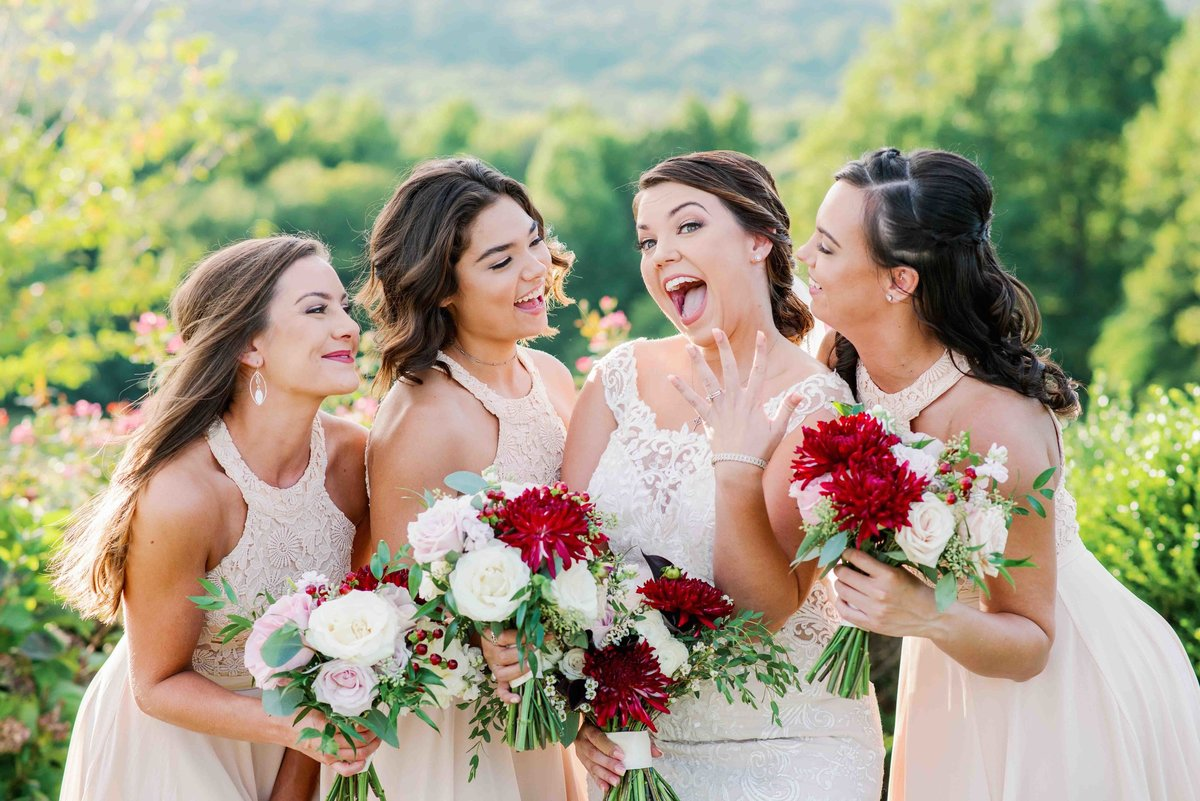 bridal party celebrates with bride that she is married