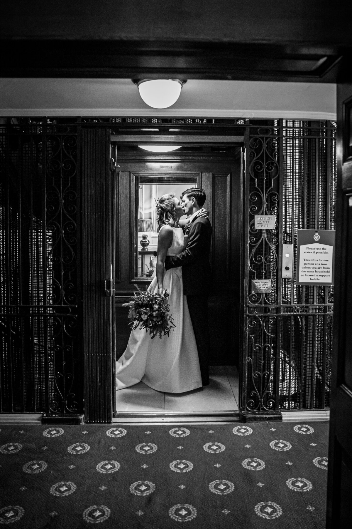 Bride and Groom kissing in a lift