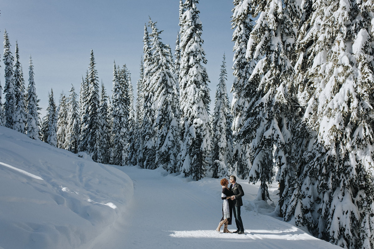Winter wedding at Silver Star Resort, bride and groom snow portrait
