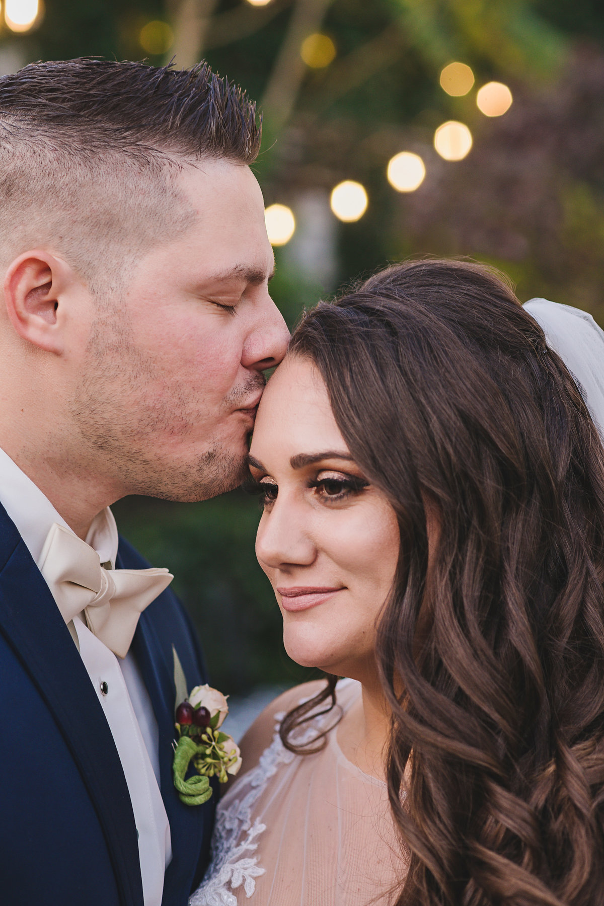 groom kissing brides forehead at Fox Hollow wedding