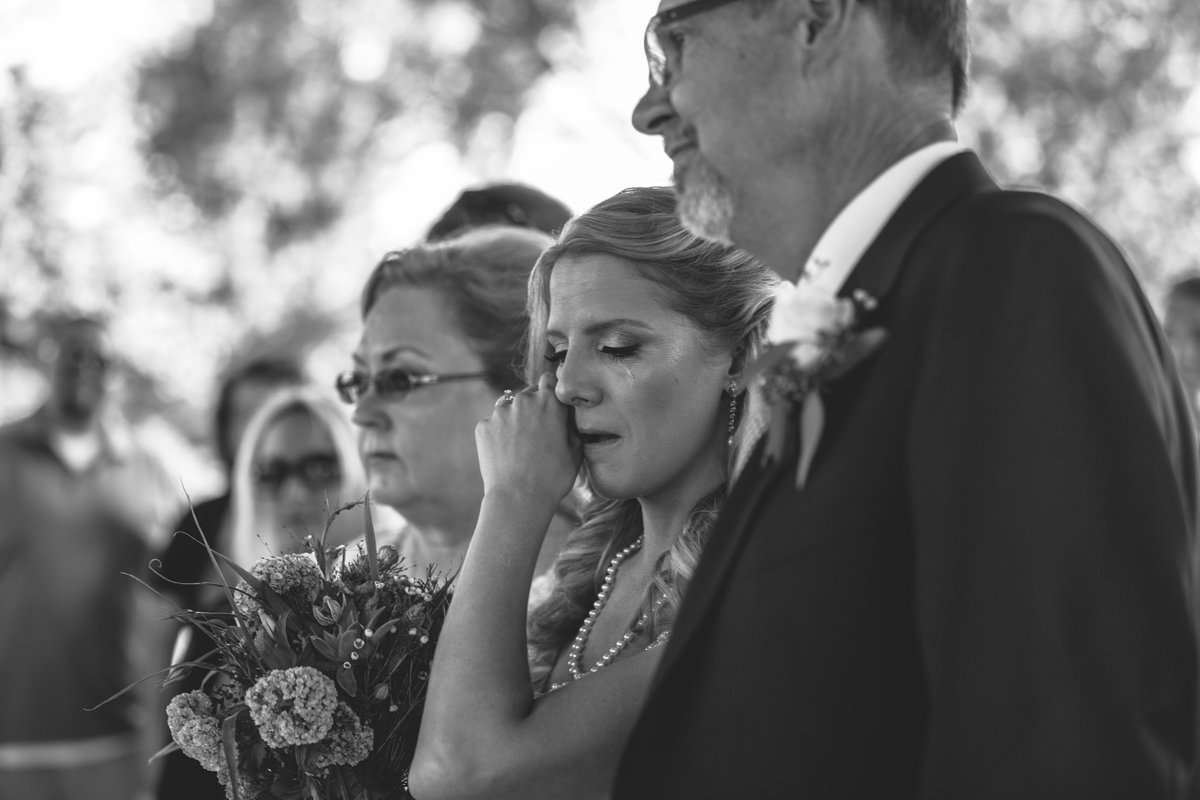 bride crying after seeing her husband for the first time