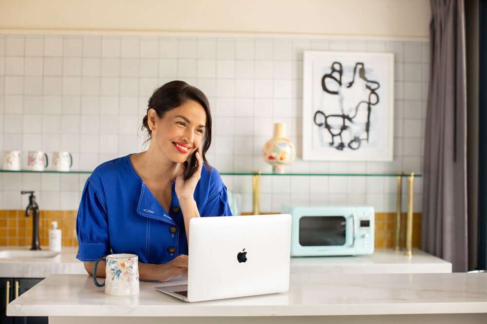 mailchimp older attractive woman working from home female CEO claremont hotel apple macbook air