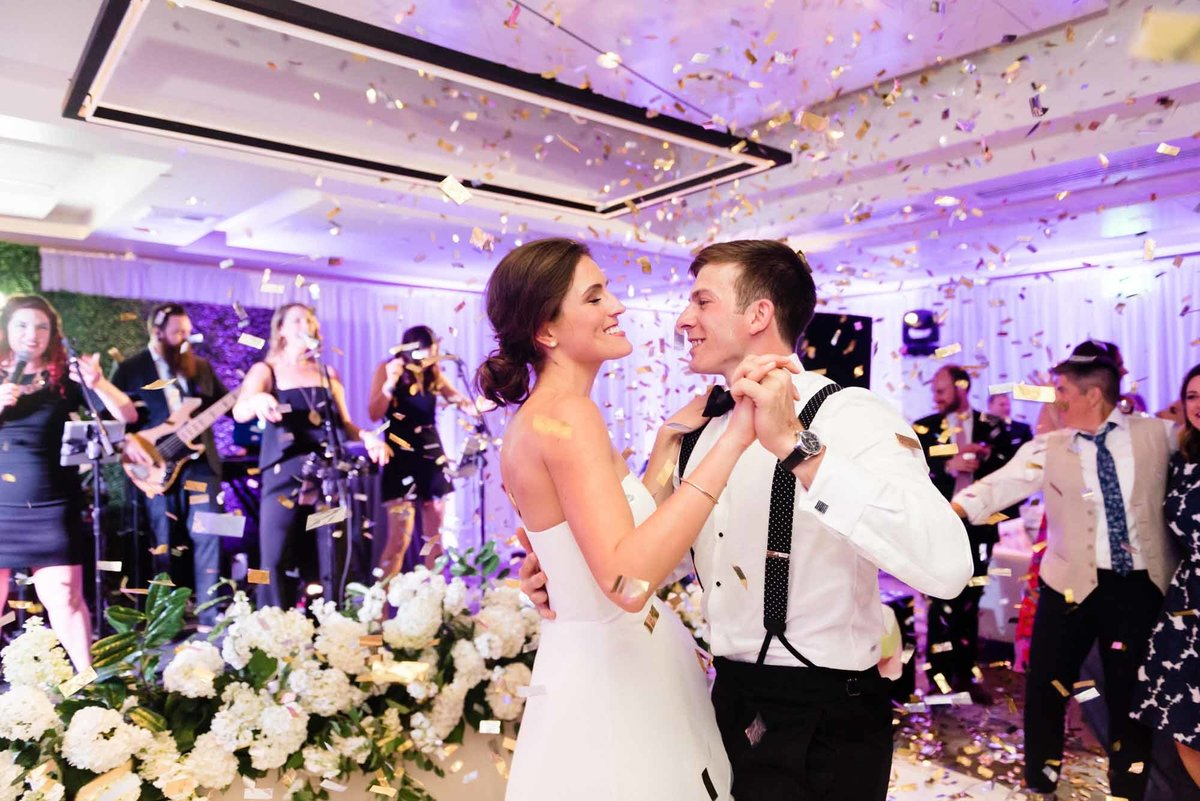 Bride and Groom dance under a cloud of confetti at this wedding designed by Flora Nova Design in Seattle.