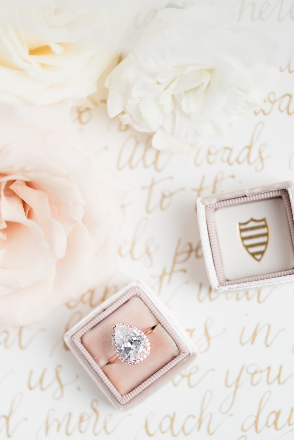 Ring in The Mrs. Box sitting atop a letter calligraphy by  Amy Sylvia Designs in Thunder Bay