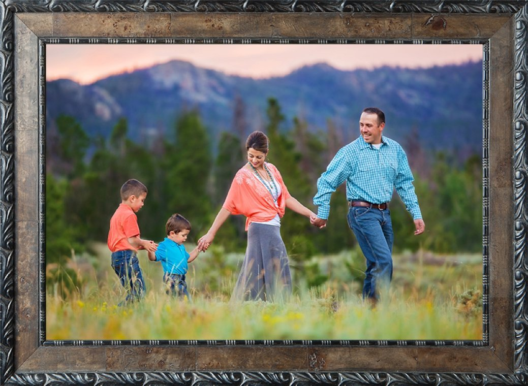 Family dressed in coral and turquoise with two little boys in the Happy Jack mountains.