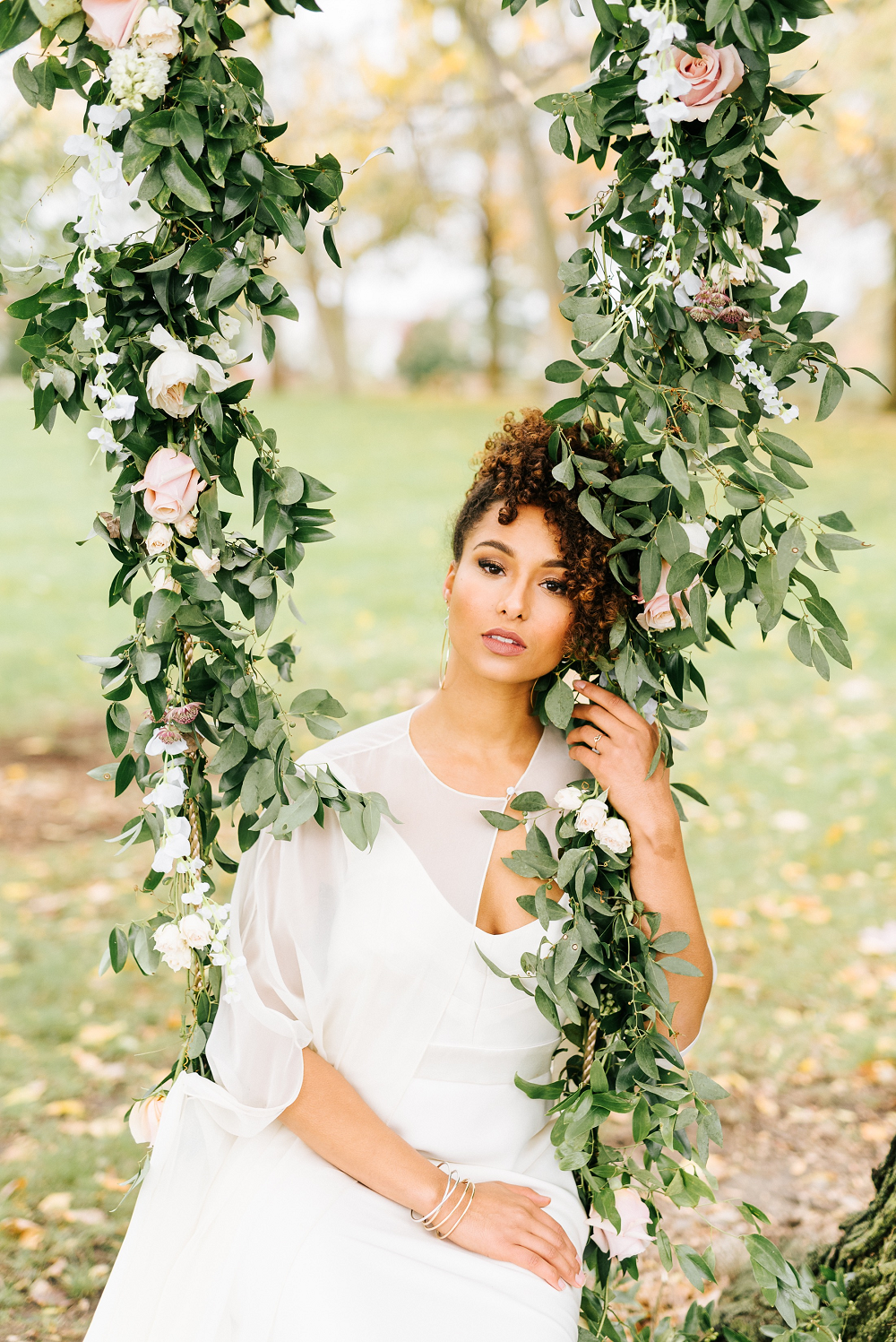 Lush Greenery Wedding Inspired Styled Shoot at Cornman Farms Bride Floral Garland Swing