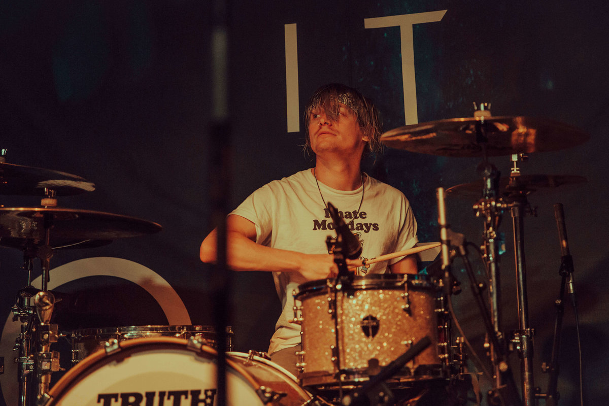 A close up of Maxx Danziger, drummer  of Set It Off onstage at The Garage in London