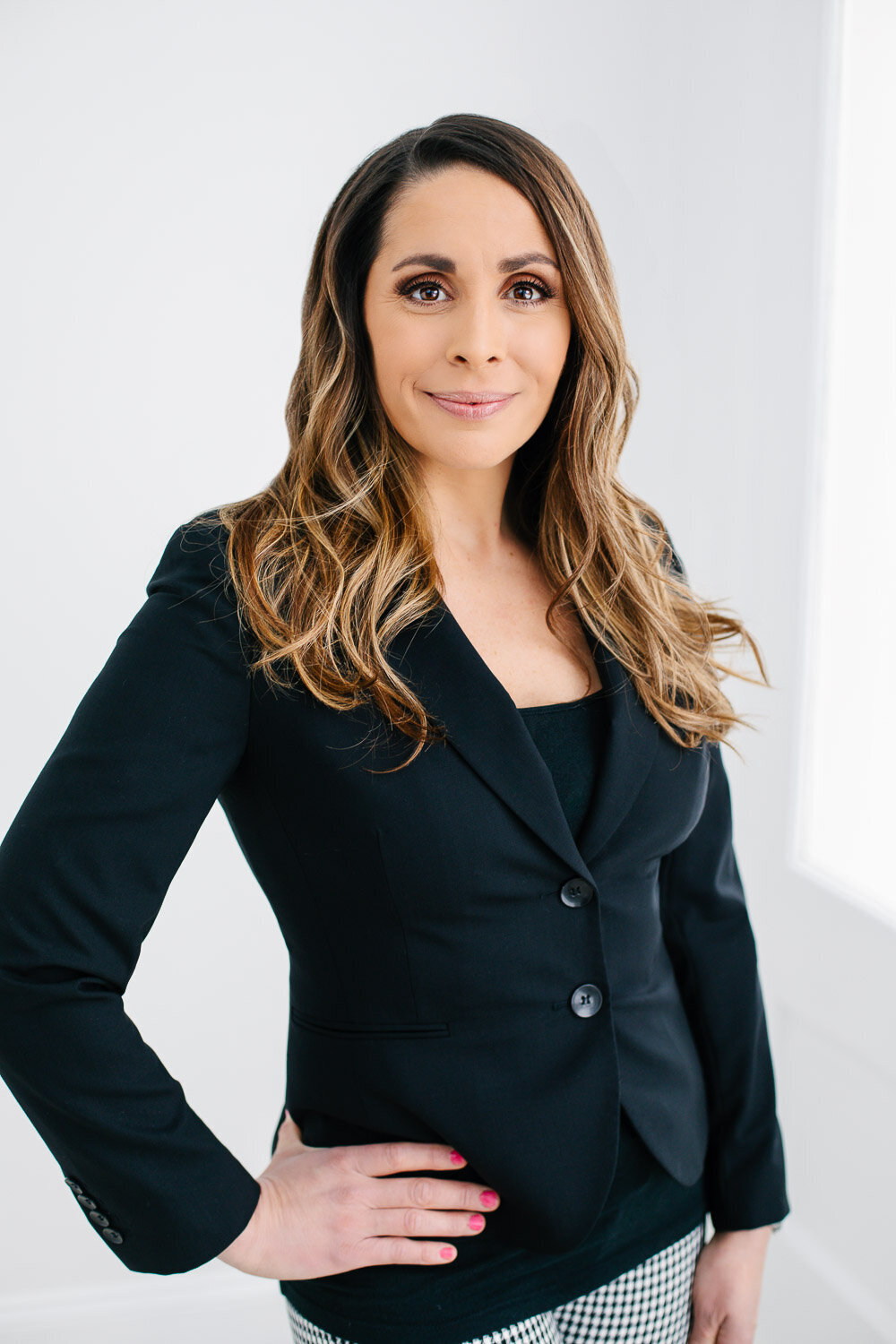Professional business headshot of woman in a blazer