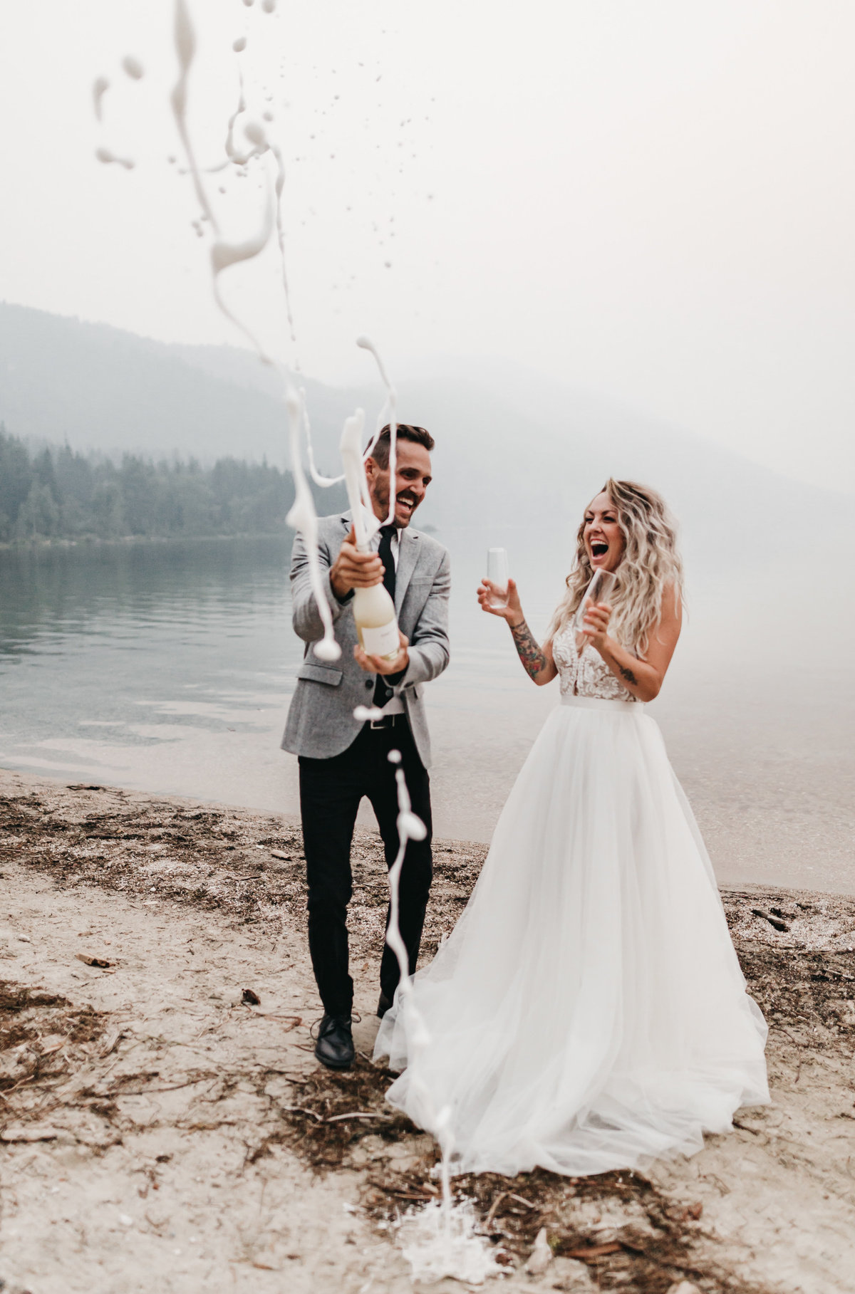 athena-and-camron-sara-truvelle-bridal-wenatchee-elopement-intimate-41-champagne-pop-bride-groom-fun-best