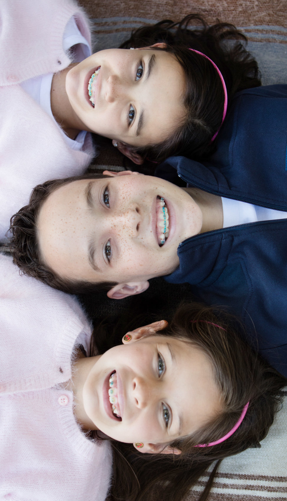 Three Kids smiling family portraits