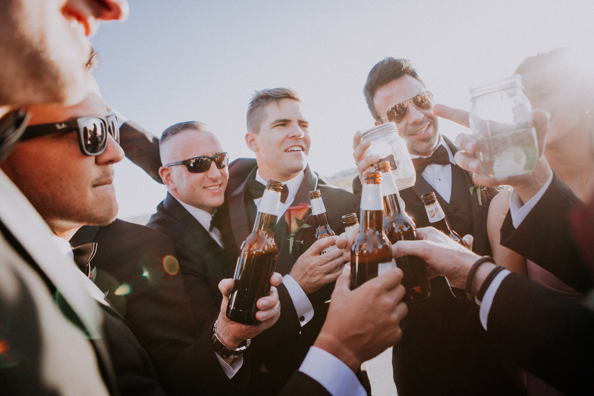 Lake Tahoe wedding pictures groomsmen toast during reception