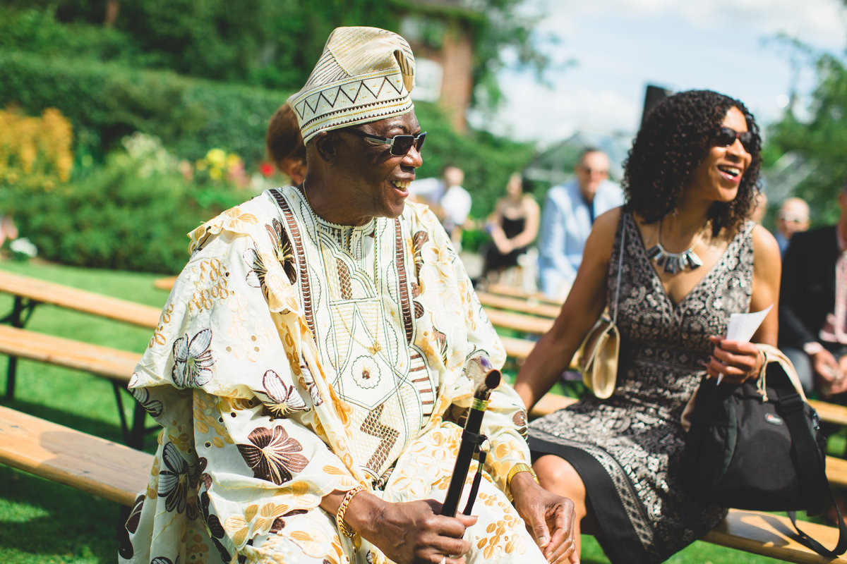 man in nigerian dress at outdoor garden wedding ceremony