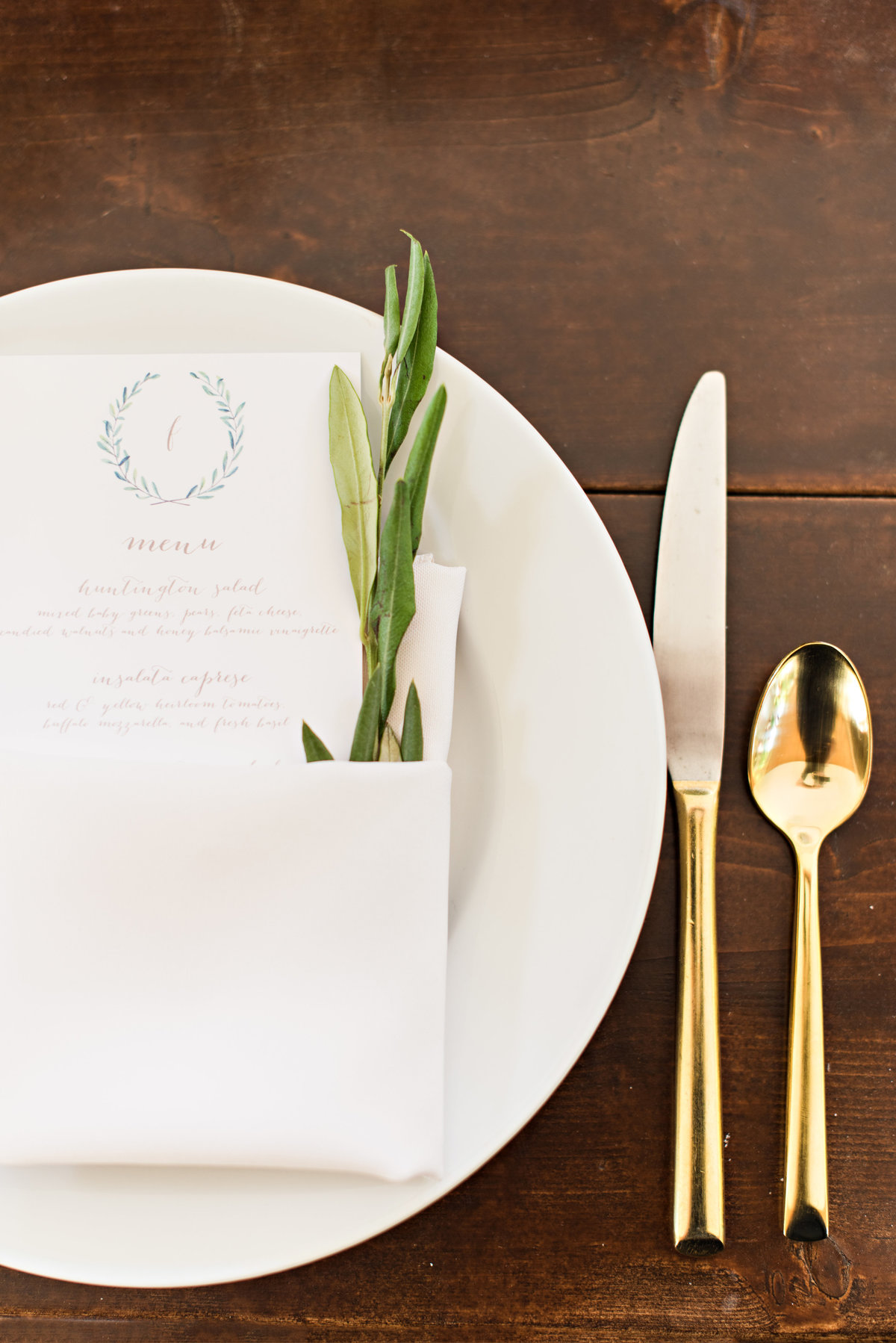place setting at heritage farm wedding with rosemary