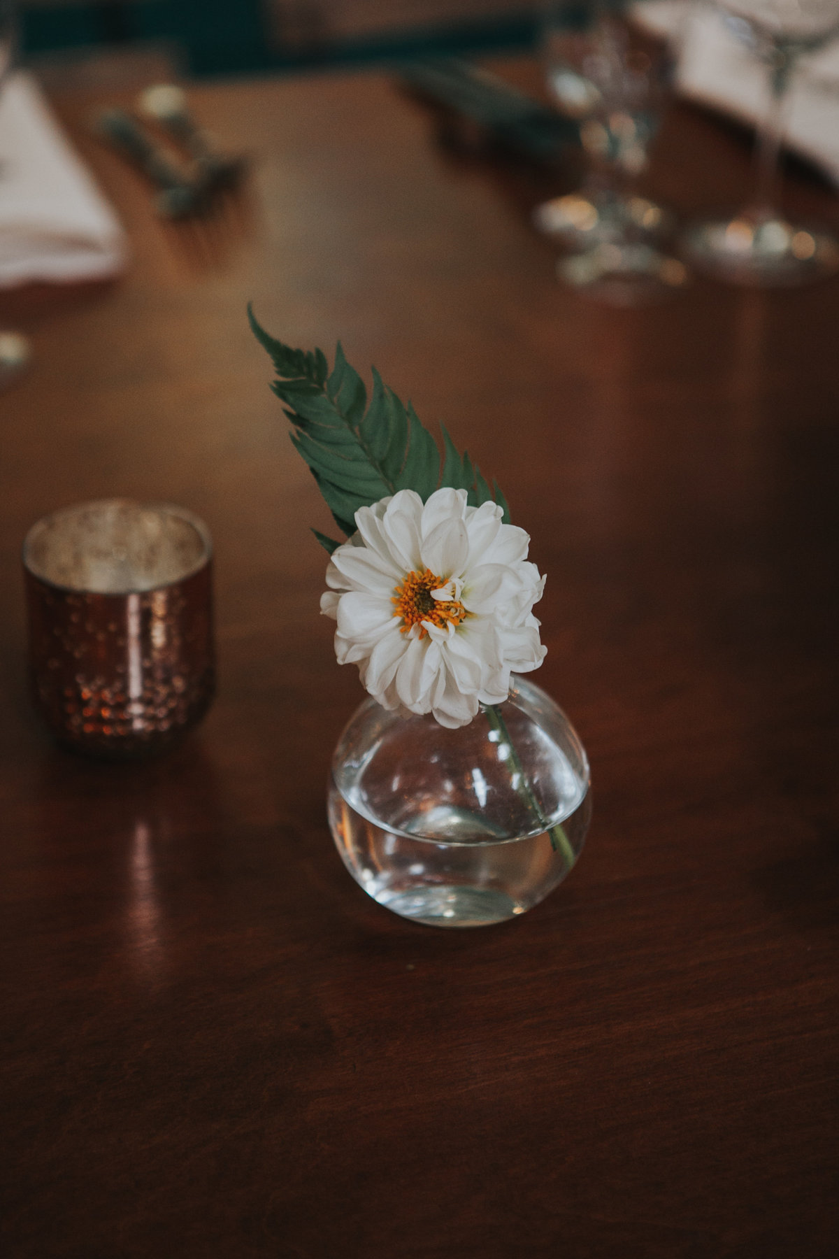 Minimalist wedding reception glass bud vase floral arrangement at The Fig House