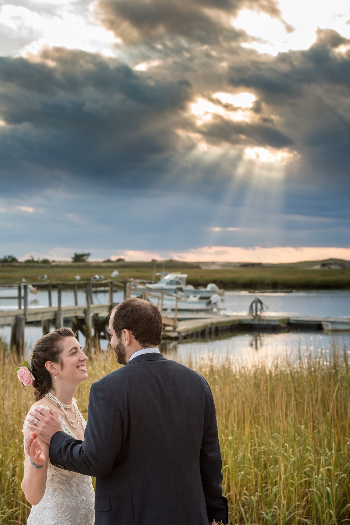 sunset photo of bride and groom on the beach in Cape Cod