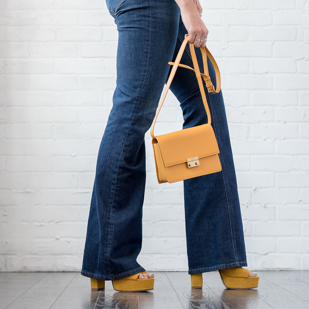 yellow shoes and yellow bag with jeans