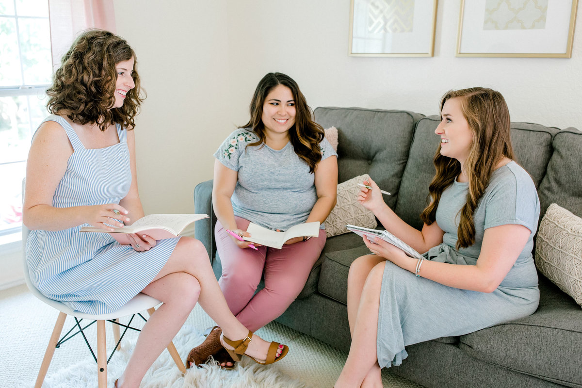 Amber Anderson meets with two women in her office