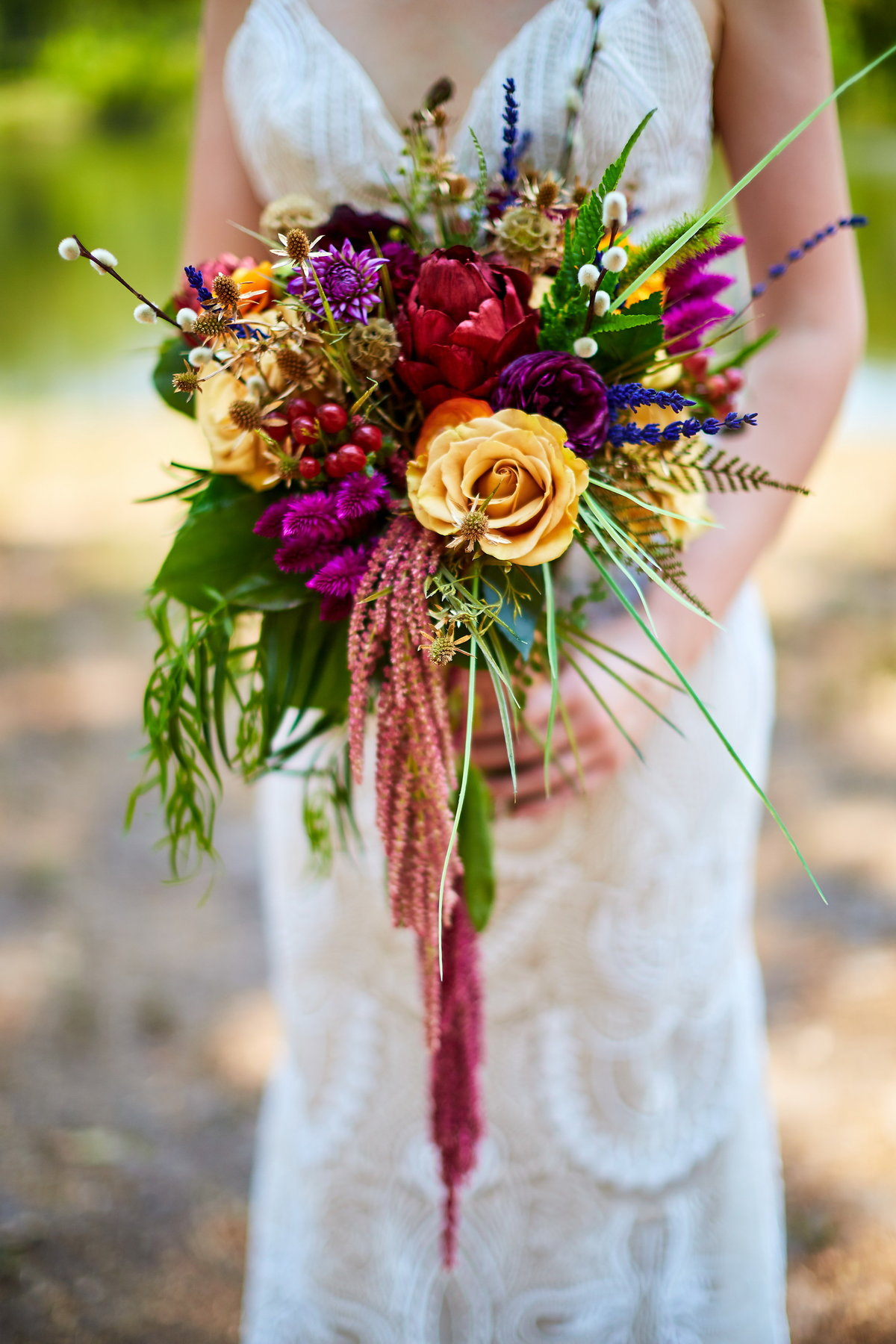 Colorful summer flower bouquet, with bride in lace dress at Charleston Woodlands, SC