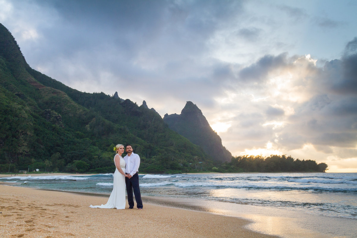 Environmental portraits of Kauai wedding at Tunnels Beach, Kauai.