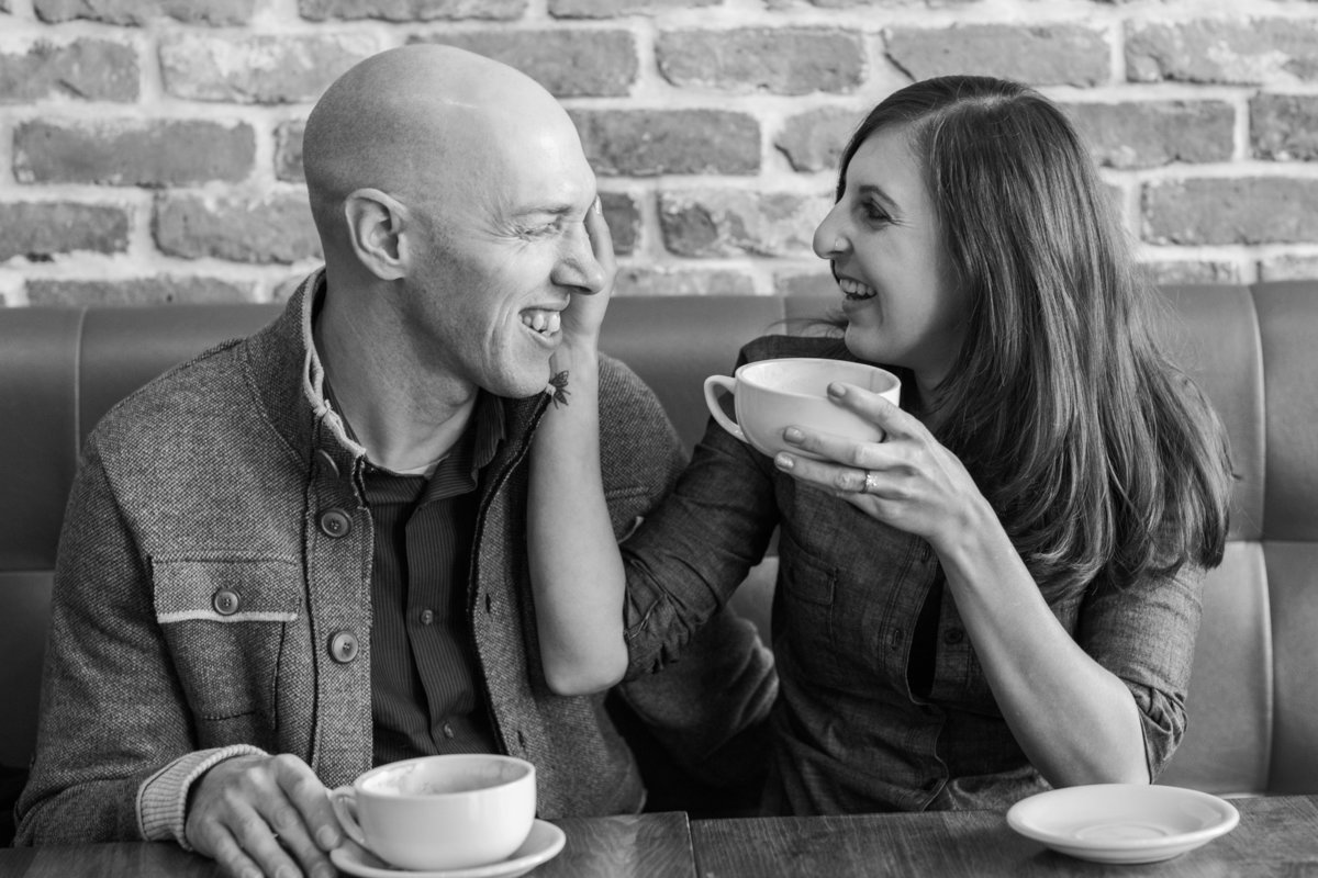 The couple takes a moment in a coffee shop in Newburyport MA