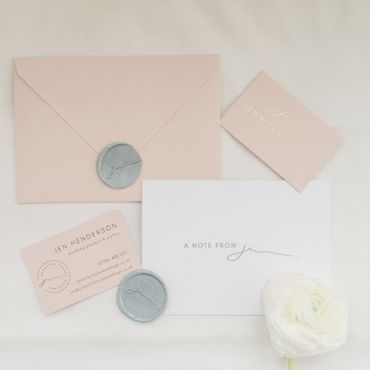 Elegant, luxury branding and feminine web design for wedding planner Jennifer Louise including logo design, colour palette, website design, blush business cards and wax seals, business stationery