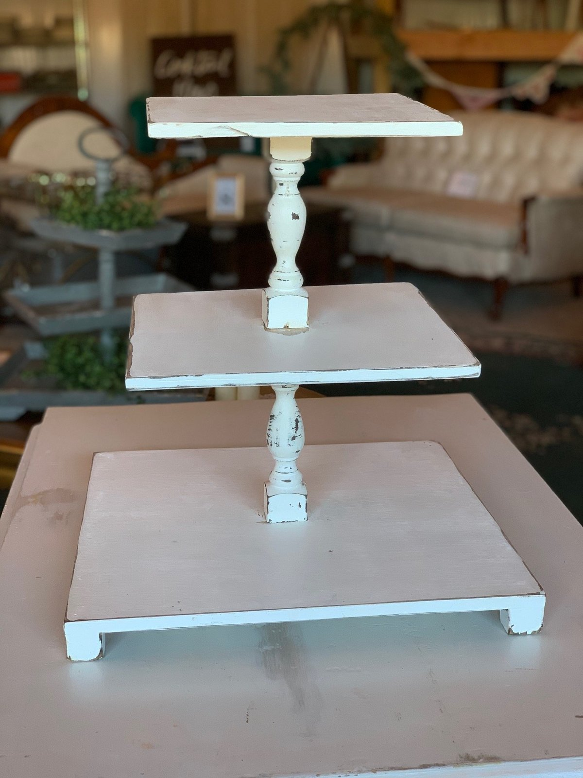 white three tiered cupcake stand
