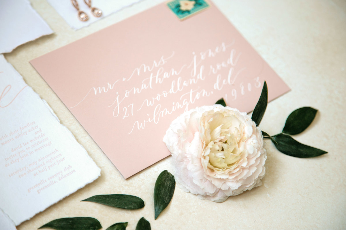 Pink envelope with hand lettering