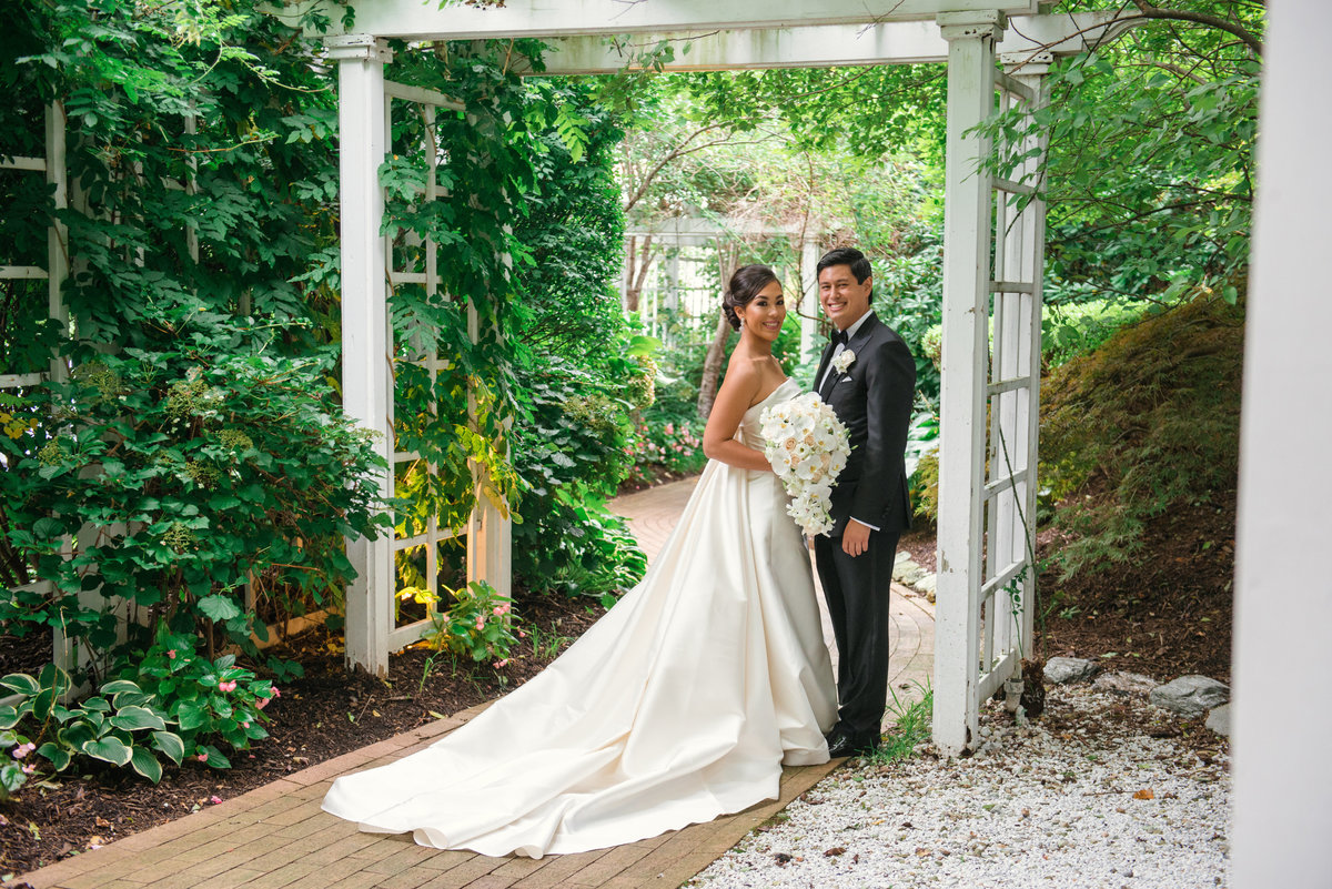photo of bride and groom outdoors for wedding reception at The Garden City Hotel