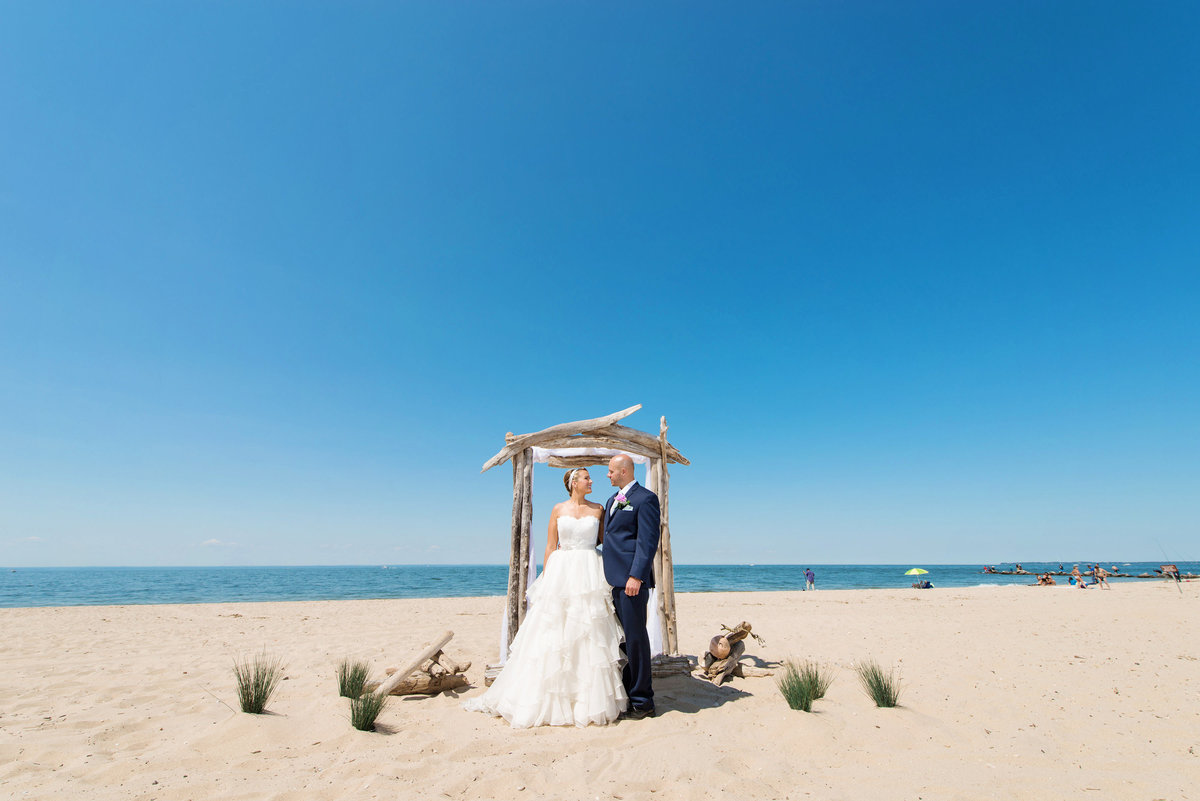 photo of bride a nd groom on the beach frm wedding at Pavilion at Sunken Meadow