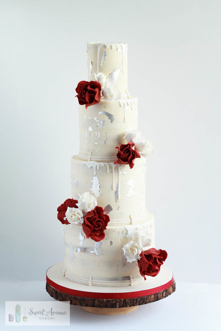 four tier semi naked rustic buttercream cake with burgundy and white roses and silver foil, Hamilton ON wedding cakes