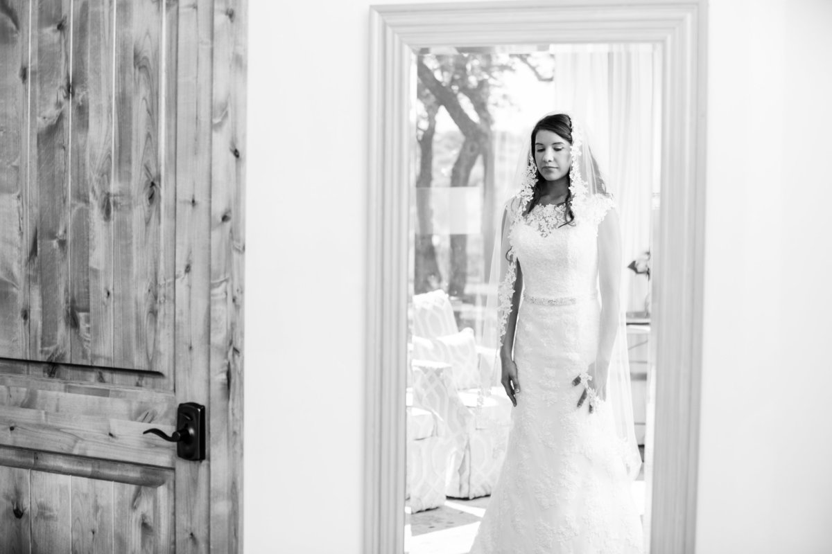 canyonwood ridge wedding photographer bride looks in mirror 250 S Canyonwood Dr, Dripping Springs, TX 78620