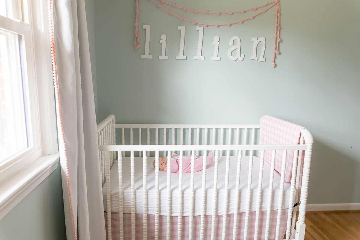 Newborn Lillian tests out her crib