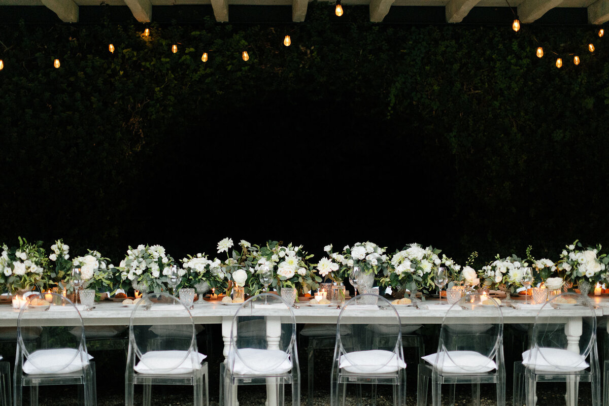 Italian Wedding Reception white florals long table under covered roof