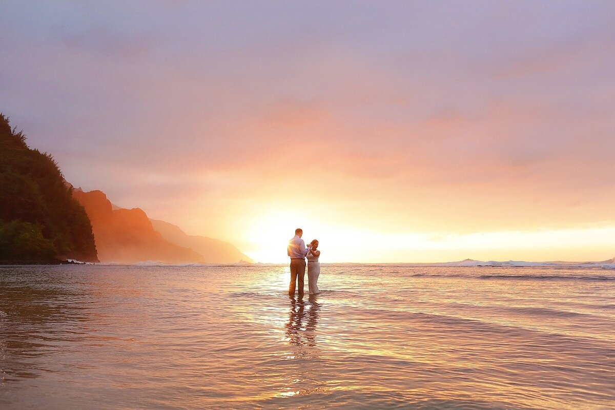 Bride and groom share their first dance in the water after their Kauai elopement