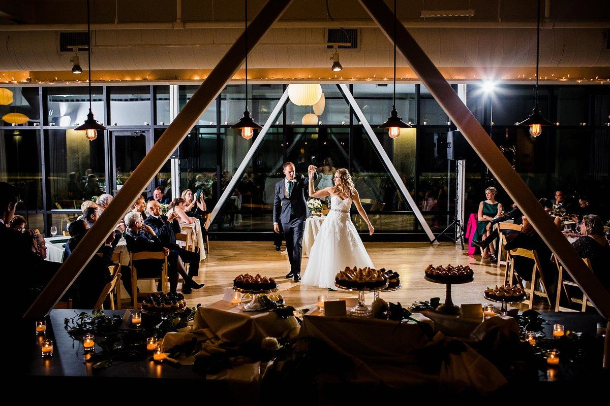 A bride and groom share their first dance together at a Greenhouse Loft wedding reception in Chicago.