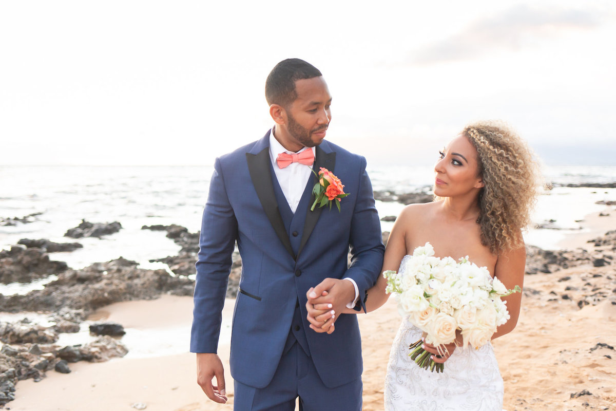 maui wedding photography bride and groom holding hands