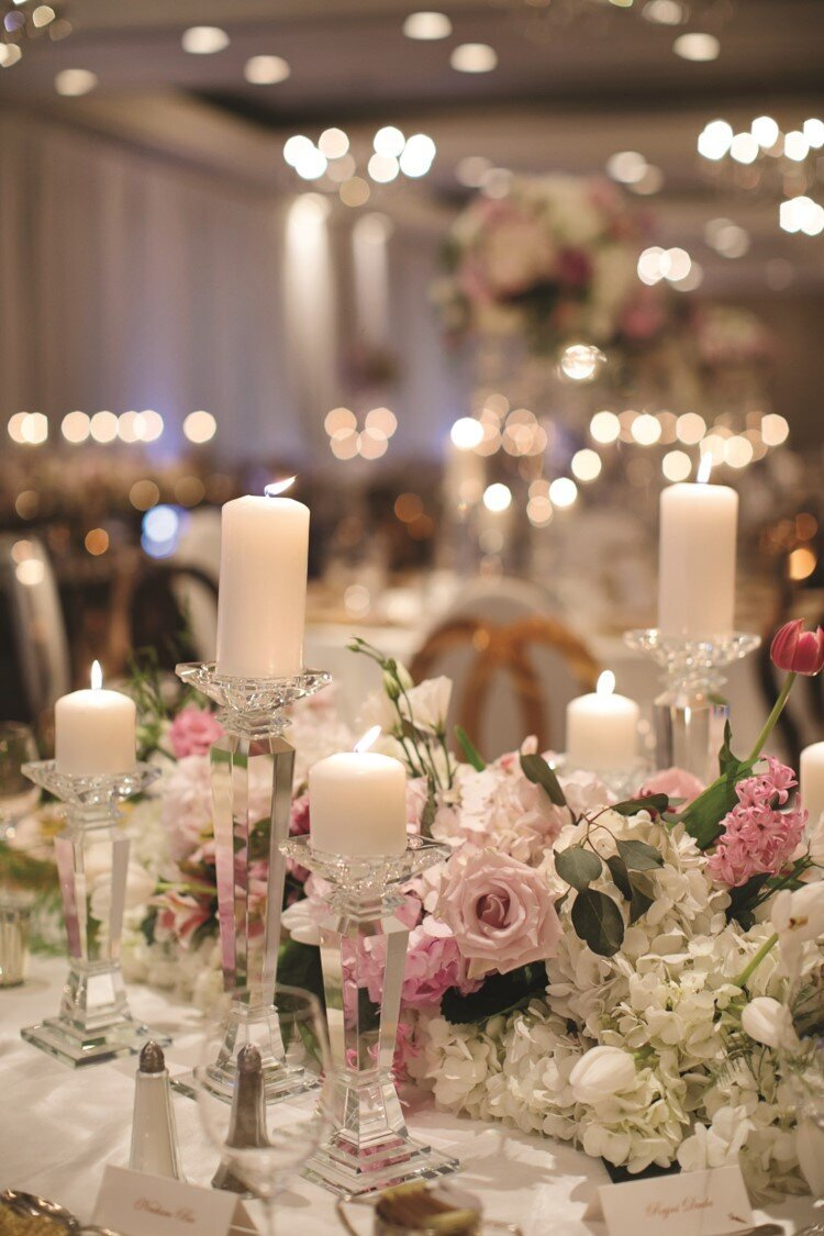 blush-gold-wedding-reception-candles-flowers-centrepieces