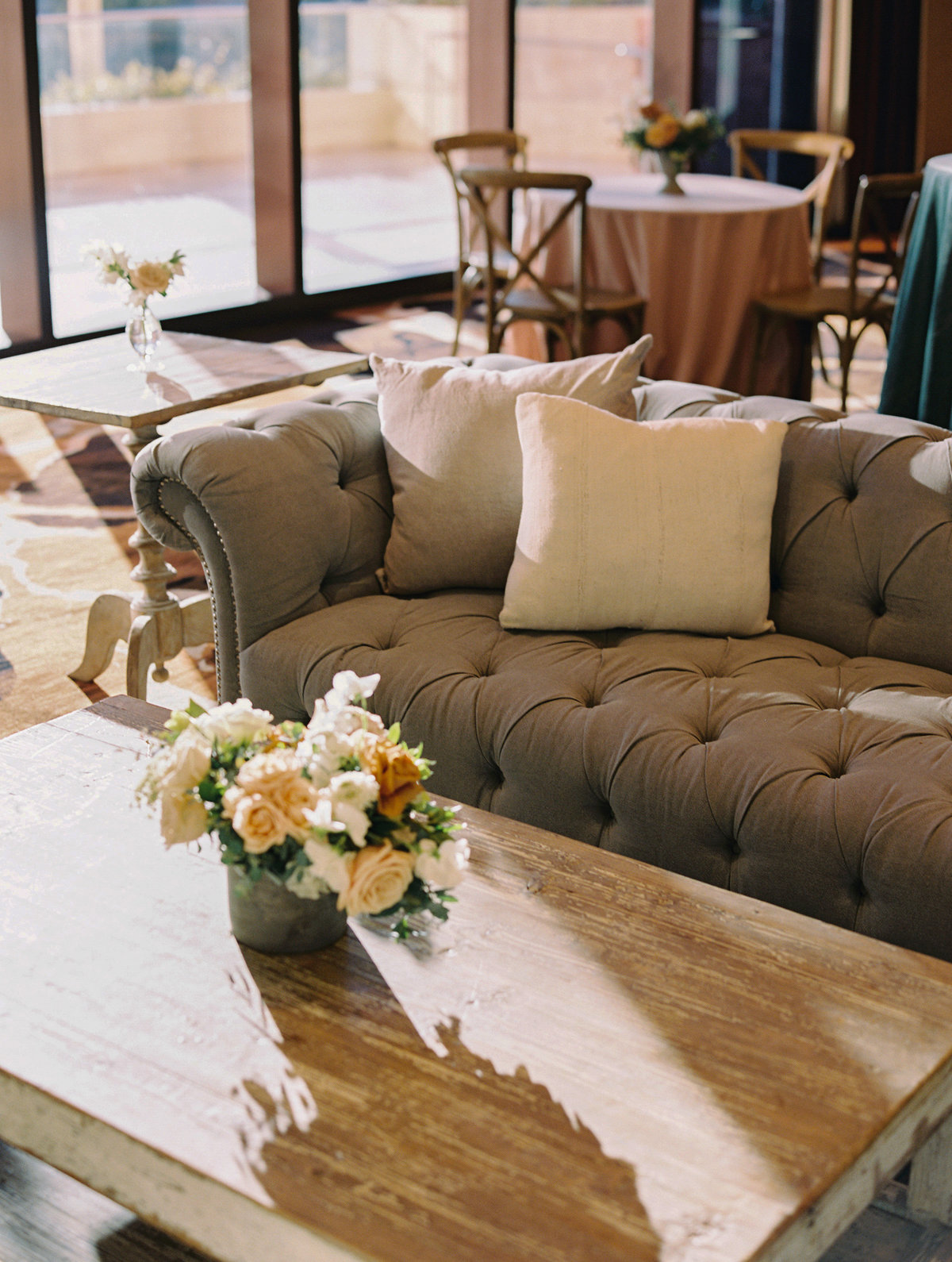 a picture of a grey tufted sofa and wood coffee table  furniture grouping at a cocktail hour at Red Rock Casino in Las Vegas