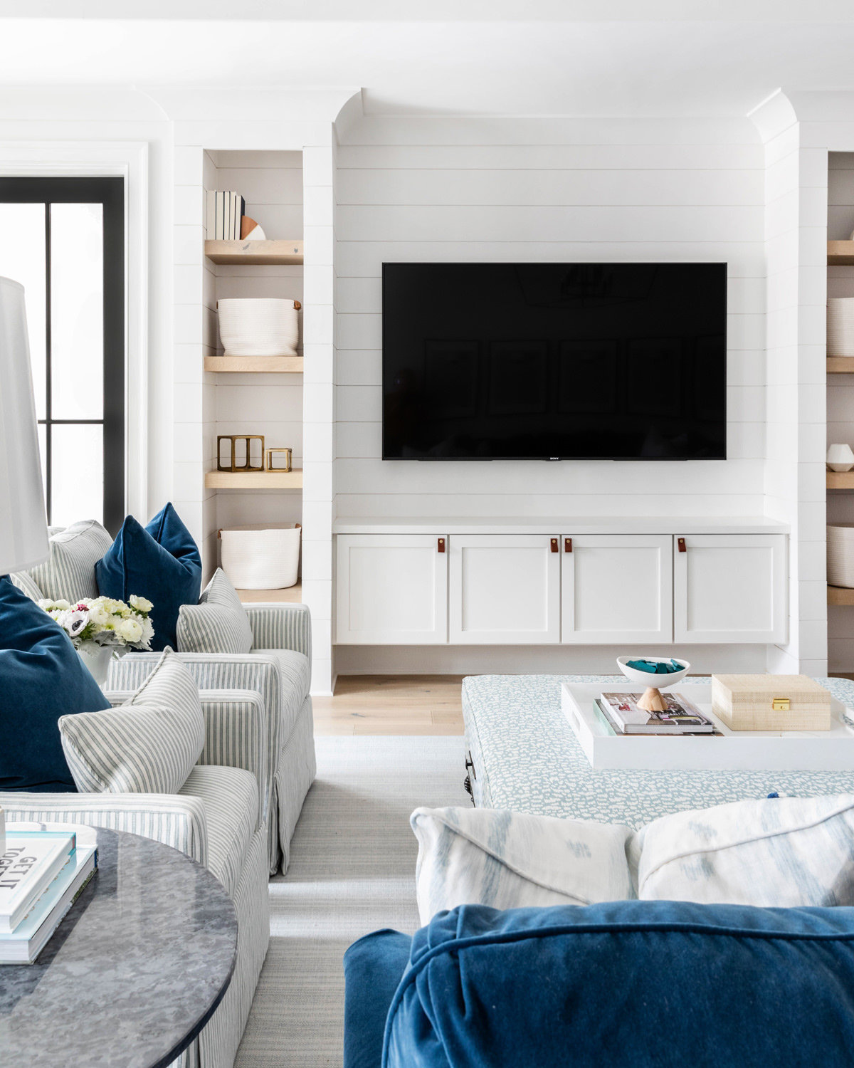 Blue-and-white-shiplap-kid-friendly-basement-living-room-2