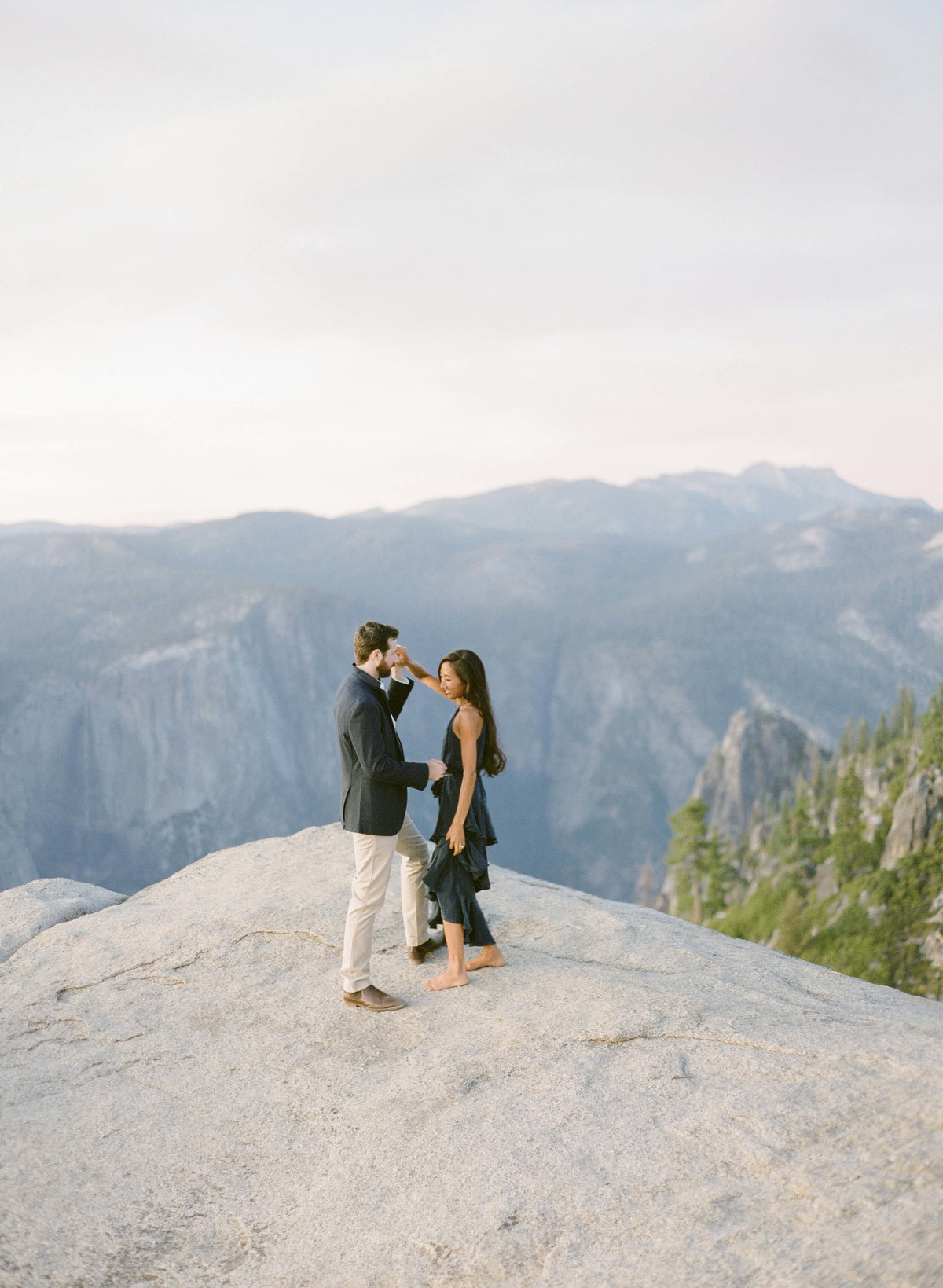 85-KTMerry-destination-engagement-photography-Yosemite-couple-dancing
